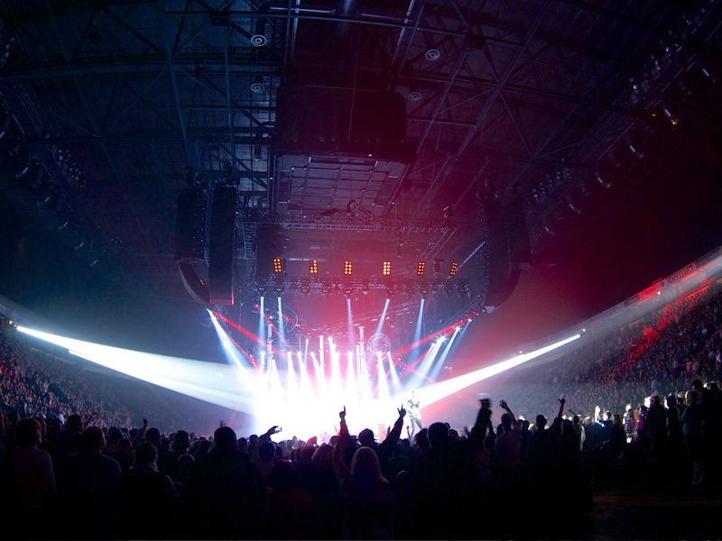 people in arena at a live concert